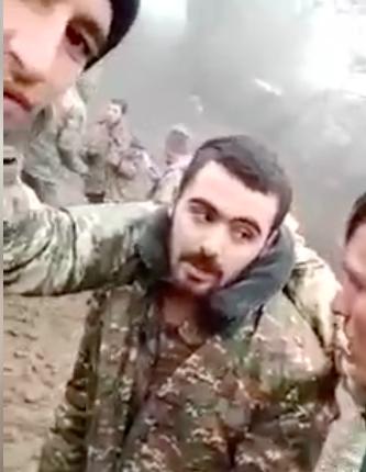 An Armenian POW is paraded on social media and beaten